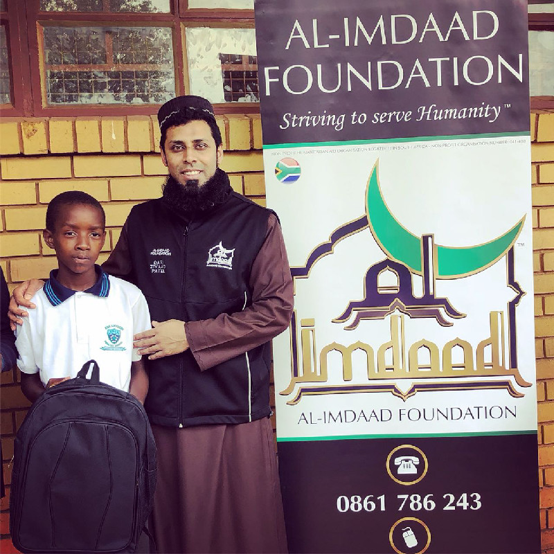Al-Imdaad Foundation's Qari Ziyad Patel together with a learner during a recent Back-2-School distribution in Soweto