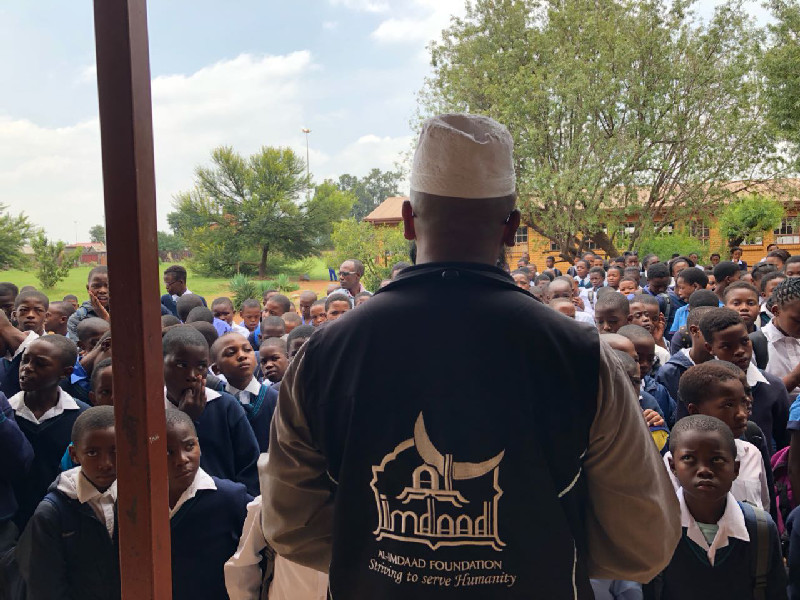 Representatives from Al-Imdaad Foundation's Gauteng office address learners at Enkanyezini Primary School in Phiri, Soweto