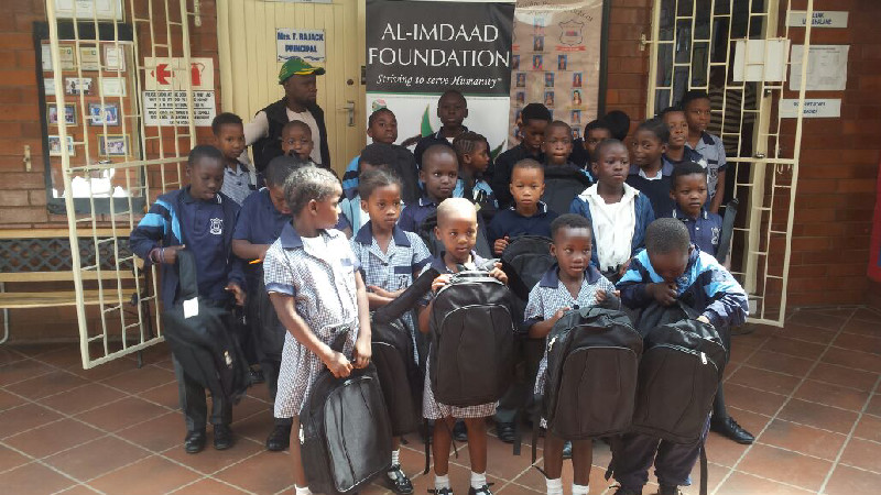 Many learners in South Africa who do not have bags still use plastic packets to carry their school books