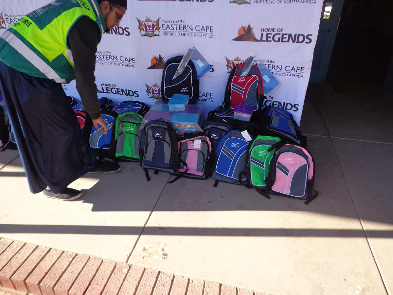 A team member arranges the schoolbags ahead of the distribution programme