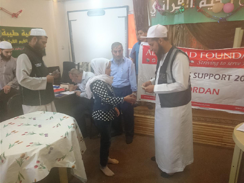 Here volunteers are distributing assistance to Palestinain orphans at the Ibnul Qayim centre in the Jerash refugee camp