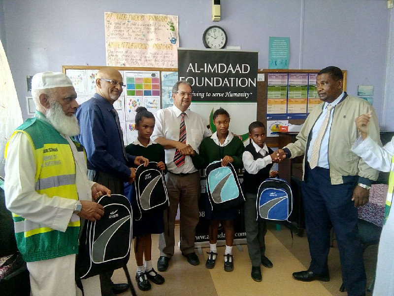 Team members together with circuit managers from the Department of Education were present for the distributions