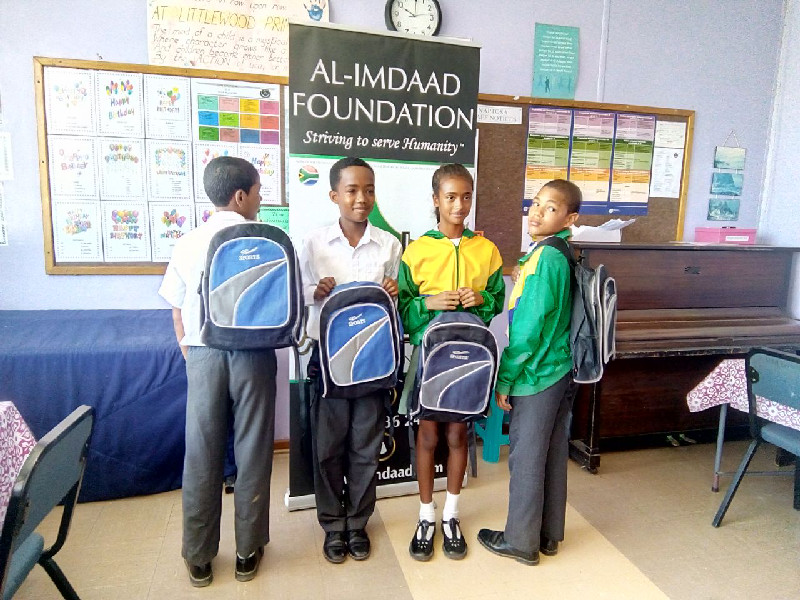 Students show off their new school bags at Littlewoods Primary in Eastridge