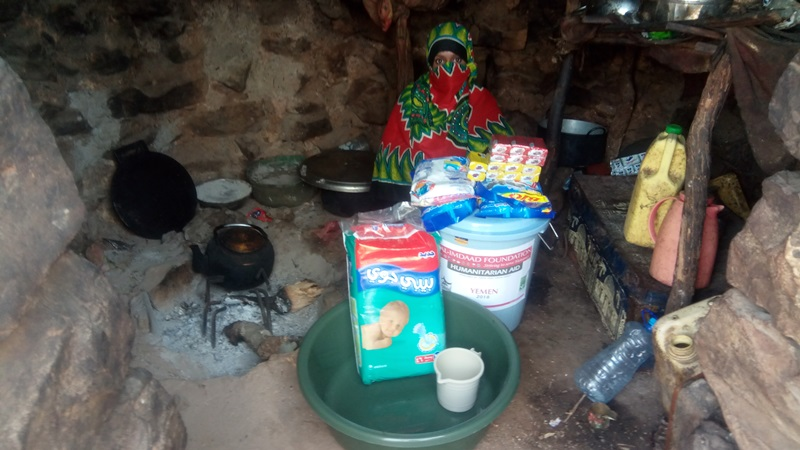 A traditional family dwelling in Socotra where the woman of the house has received a hygiene pack